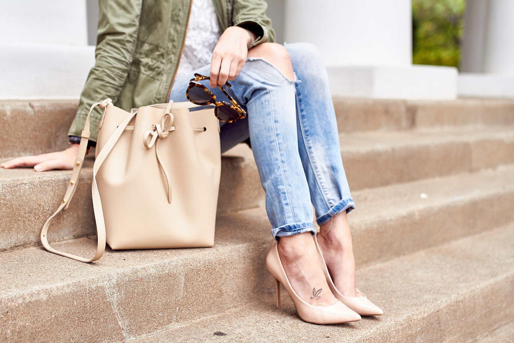 fashion-jackson-mansur-gavriel-bucket-bag-denim-ripped-skinny-jeans-nude-pumps-tortoise-sunglasses-utility-jacket