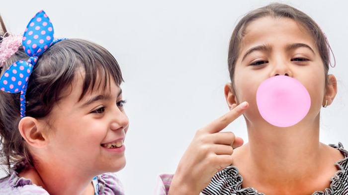 Portraits of beautiful little girls blowing bubbles; Shutterstock ID 362218376; PO: chewing-gum-digestion-stock-today-tease-160519; Job: CR; Client: TODAY Digital