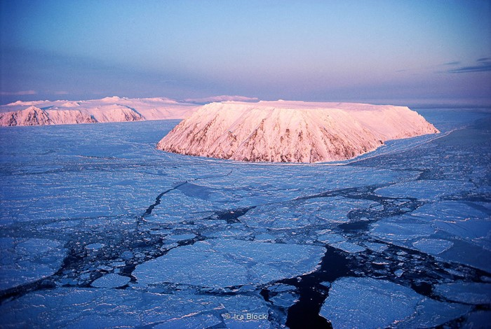 Aerial of Little Diomede Island, with Big Diomede in background.  Located in the Bering Strait, 25 miles northwest of Cape Prince of Wales and 80 miles northwest of Teller. The international boundary between the U.S. and Russia lies between Big and Little Diomede Islands.